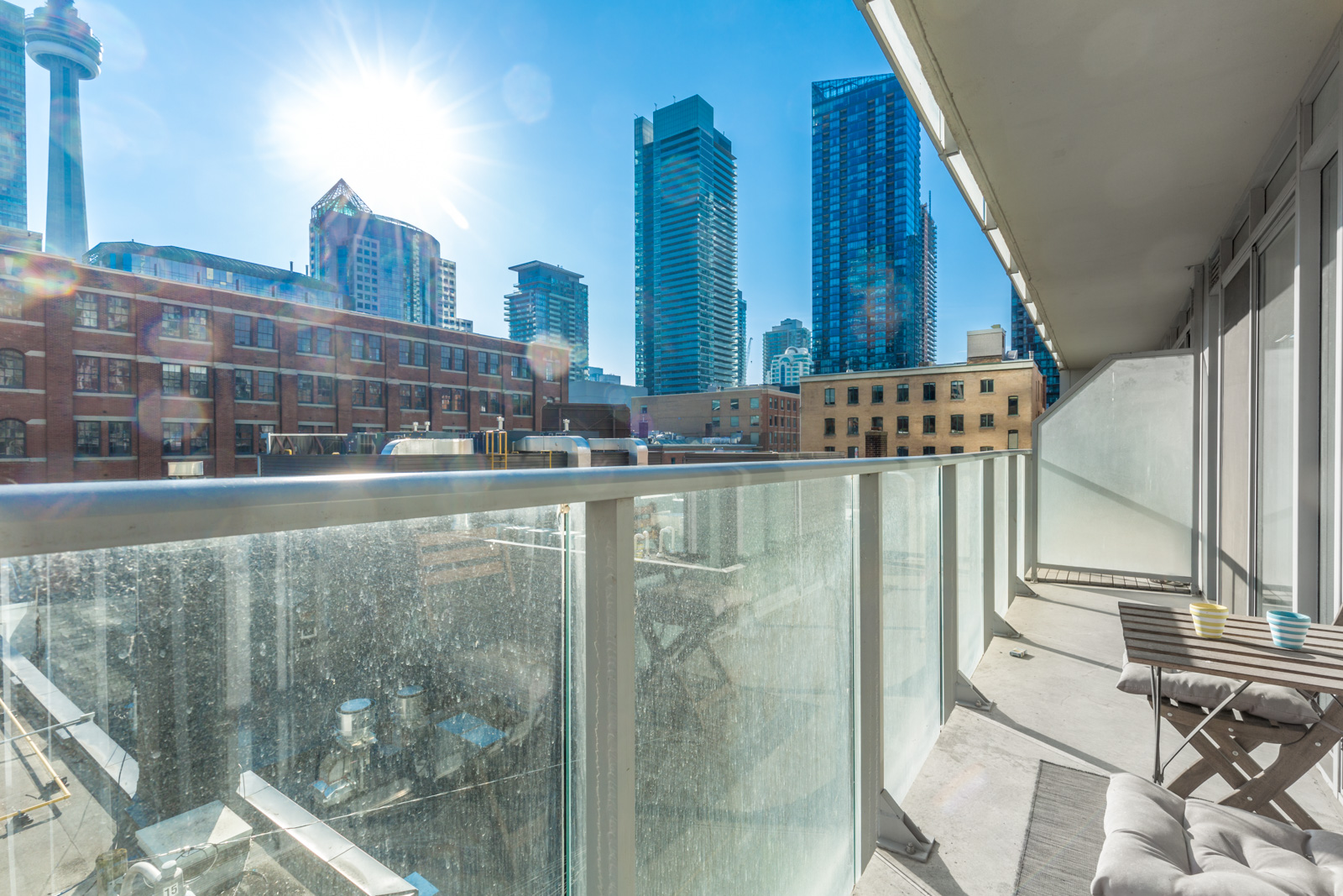 Photo of Toronto condo showing spacious balcony and view of CN Tower