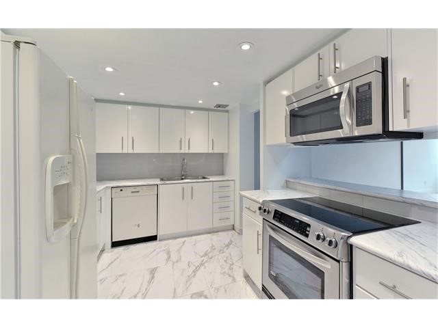 Image showing the kitchen area with new paint, potlights, and stainless steel appliances