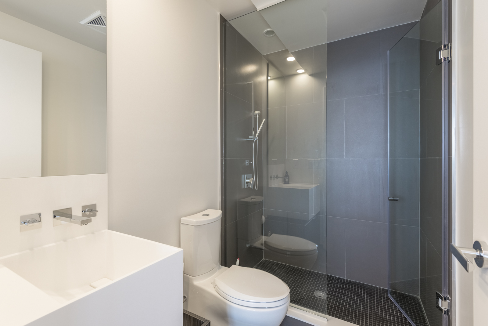 Photo showing condo bathroom with walk-in shower