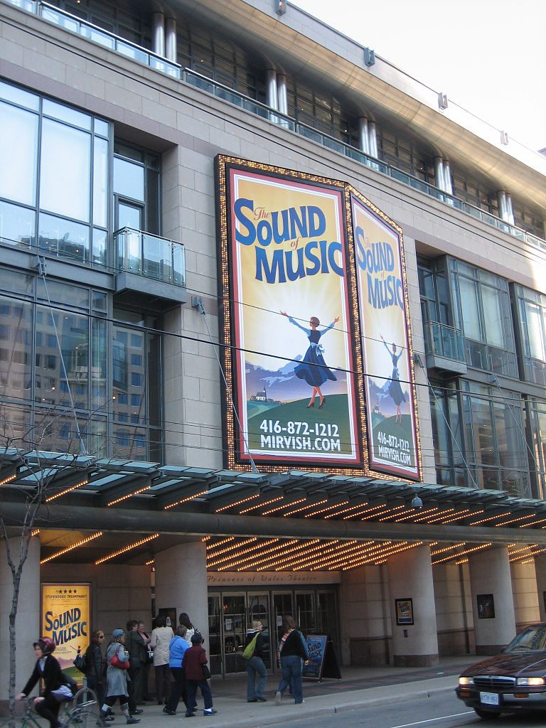 Photo shows The Princess of Wales Theatre and Sound of Music Poster