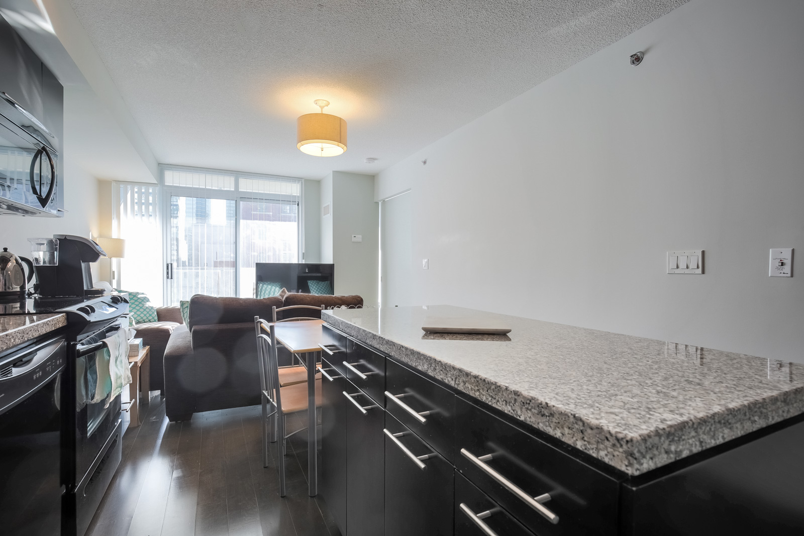 A view of the condo's granite counter-tops and kitchen island