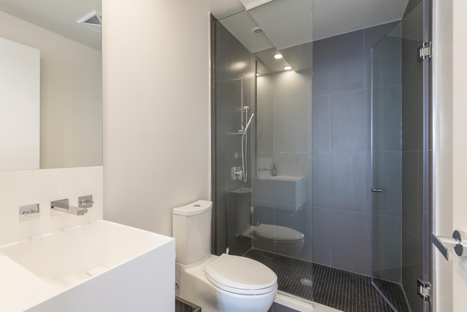Photo showing condo bathroom with walk-in shower