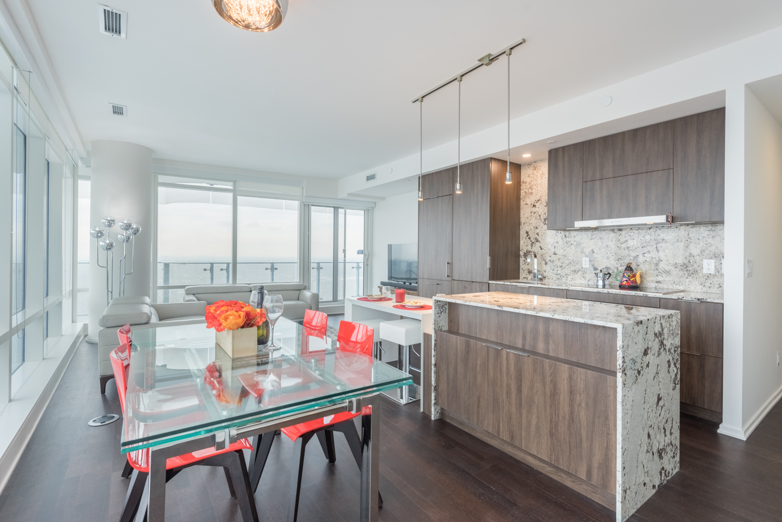 This image shows the condo's open concept design, including the kitchen and living room
