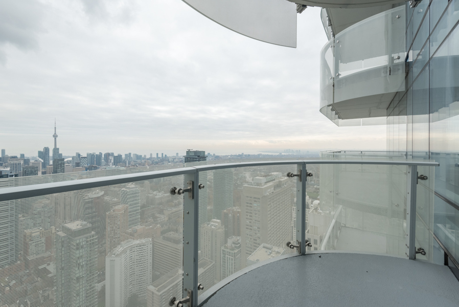 This image shows the condo's wrap-around balcony and view of downtown Toronto