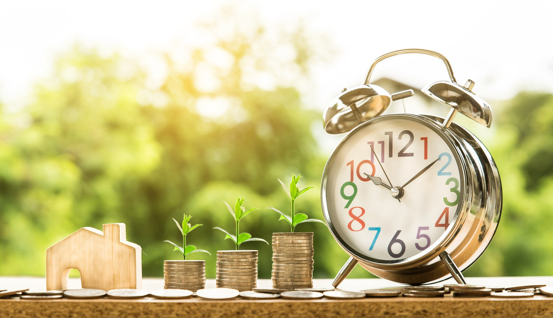 Image of clock, home and money to show growth