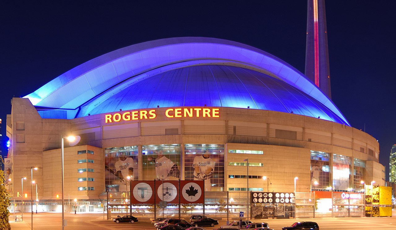 Night shot of the Rogers Centre (so, and, first of all, also, another, furthermore, finally, in addition because, so, due to. While, since, therefore same, less, rather. So while, yet, opposite, much as. Either as a result, hence, consequently, therefore, in conclusion).