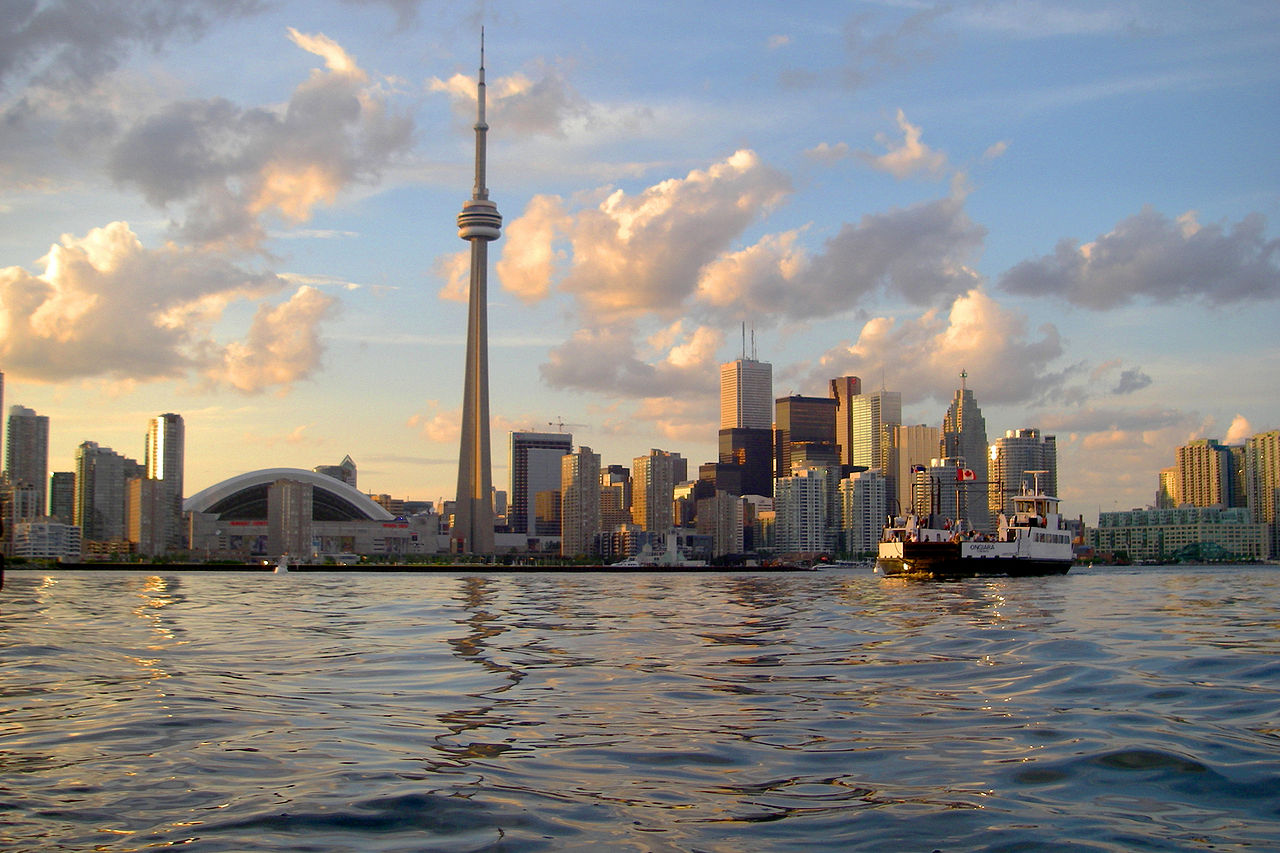 Photo of Toronto as seen from Lake Ontario. And, first of all, also, another, furthermore, finally, in addition because, so, due to, while, since, and therefore.