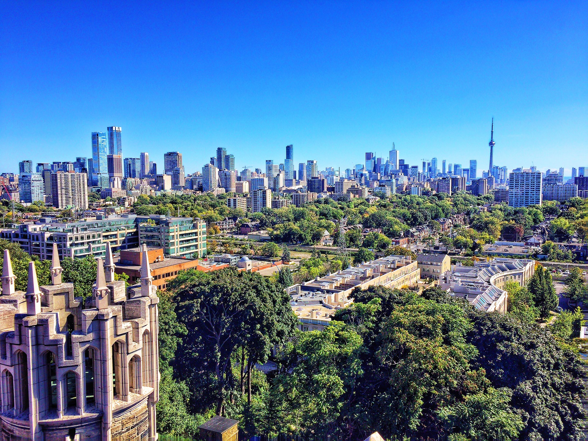 Photo of Toronto skyline from far away, showing CN Tower and Wins Lai Best Toronto Real Estate Agents.