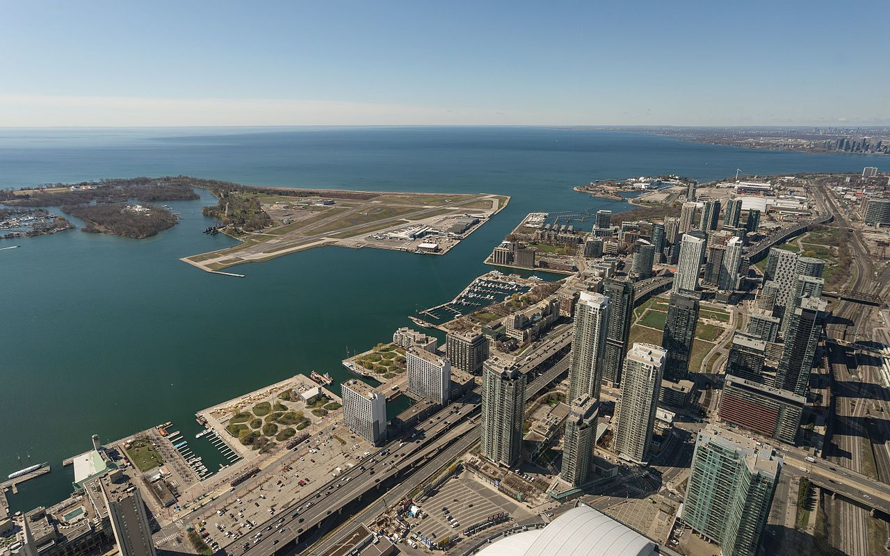 Sky view of Toronto's Waterfront showing streets, boats, and toronto real estate agent buildings.