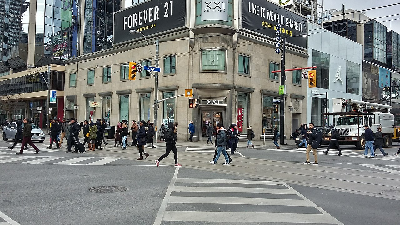 Photo of Yonge Street. So many people crossing the street.