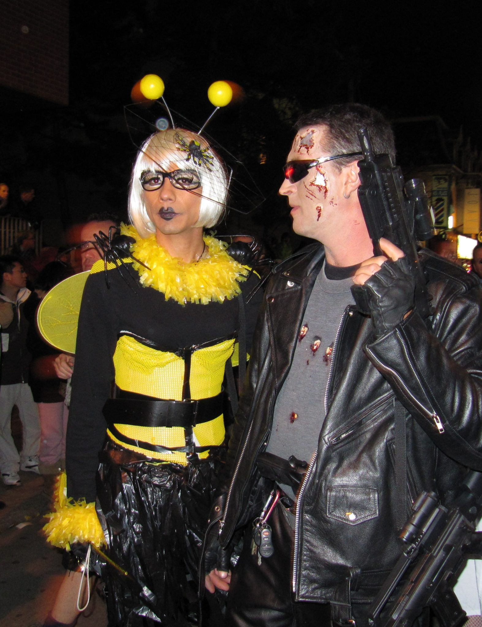 Photo of 2 people dressed as a bee and Terminator.