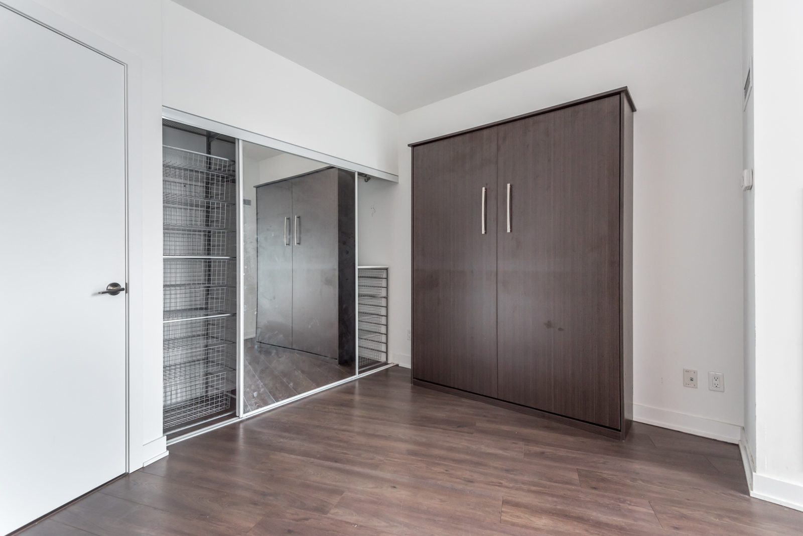 Photo showing closet with Murphy Bed tucked inside.