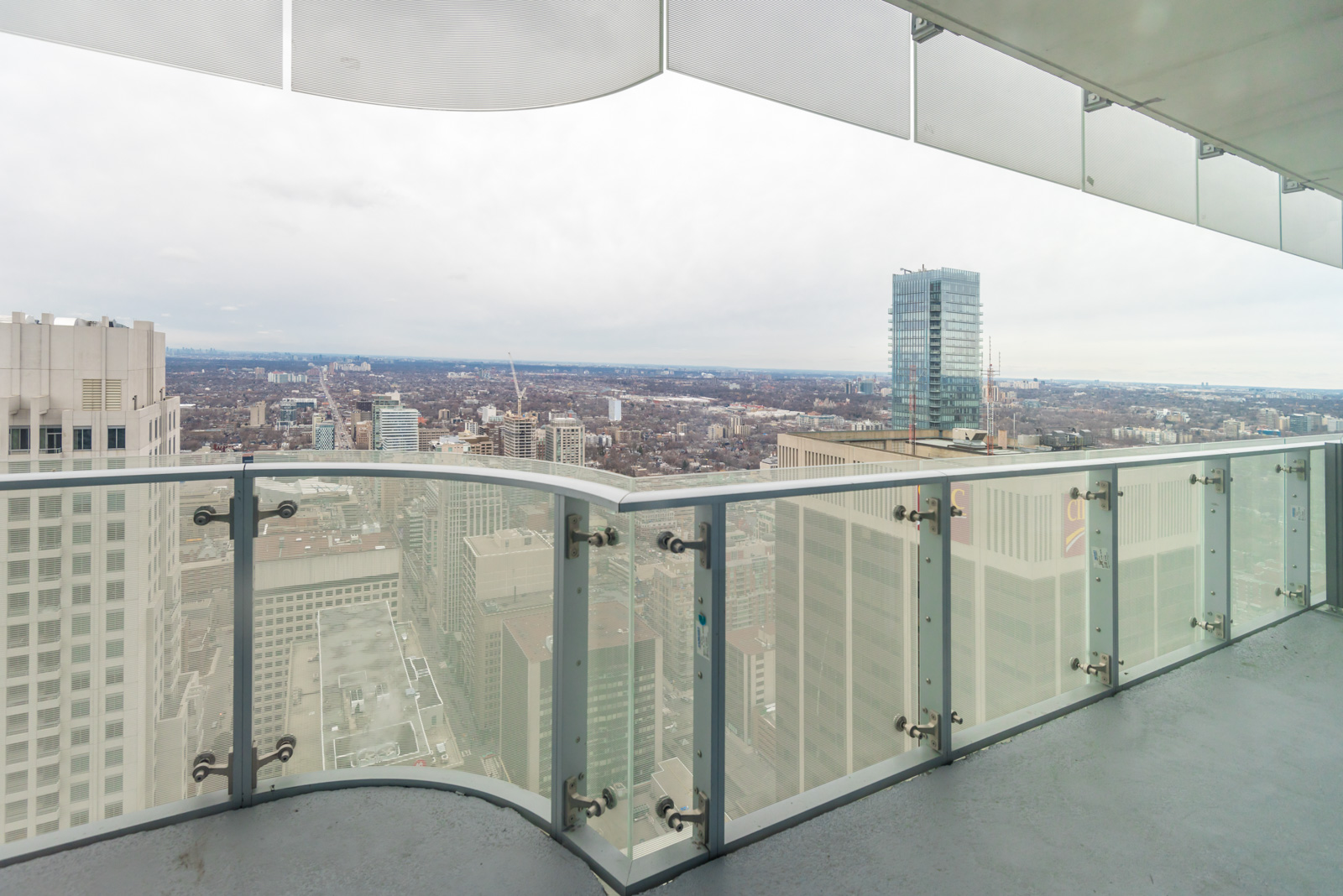 Photo of balcony showing Toronto in the distance.