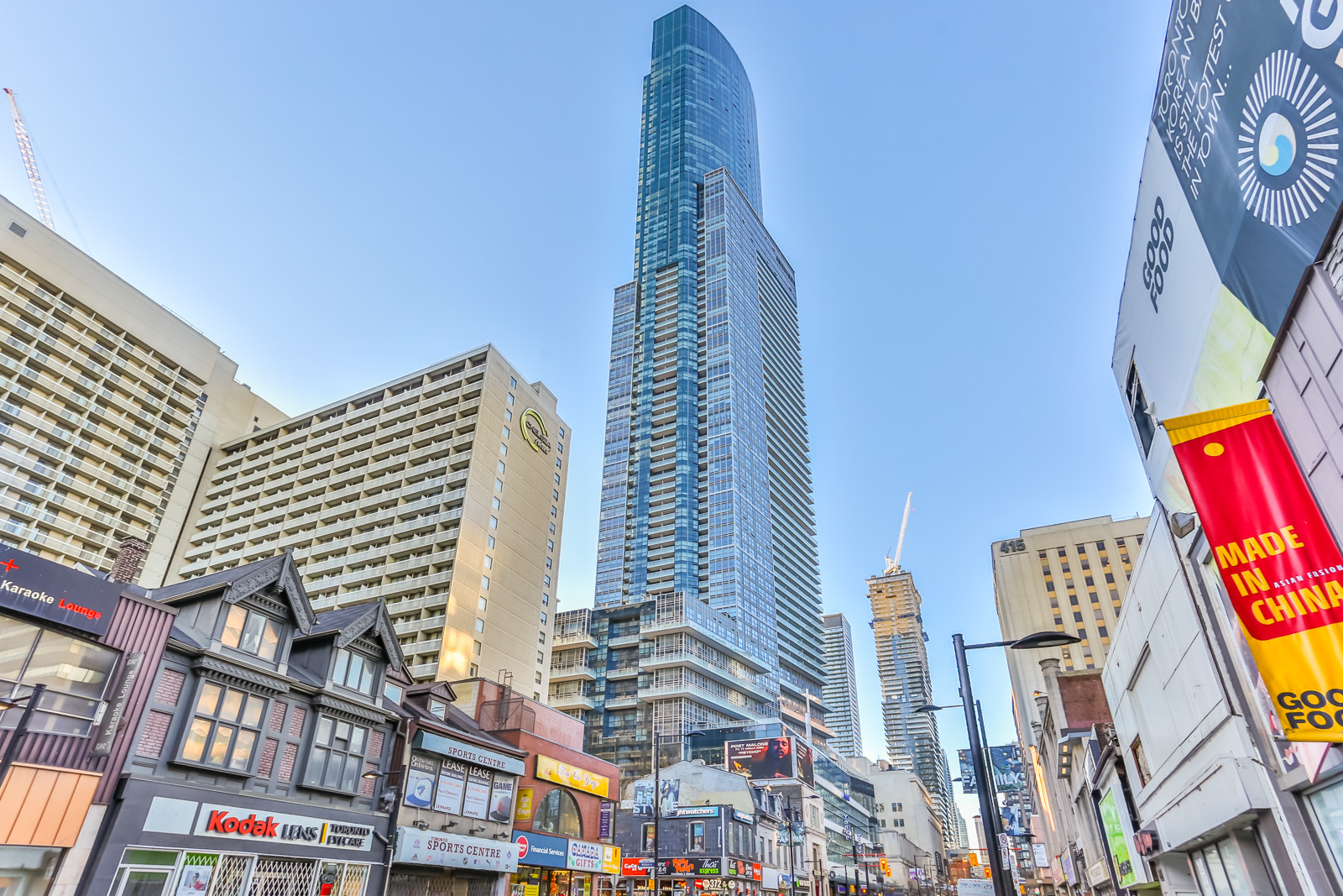 Long distance shot of 384 Yonge Street. It stands so tall among other buildings that are far less high.