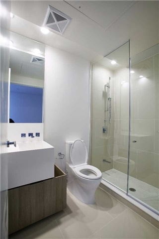 This is the second bathroom of 1 Bloor Unit 3109. It's less dark but has the same sharp angles.