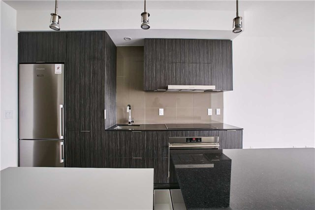 This image shows 1 Bloor Unit 3109 kitchen, appliances, lights and island.