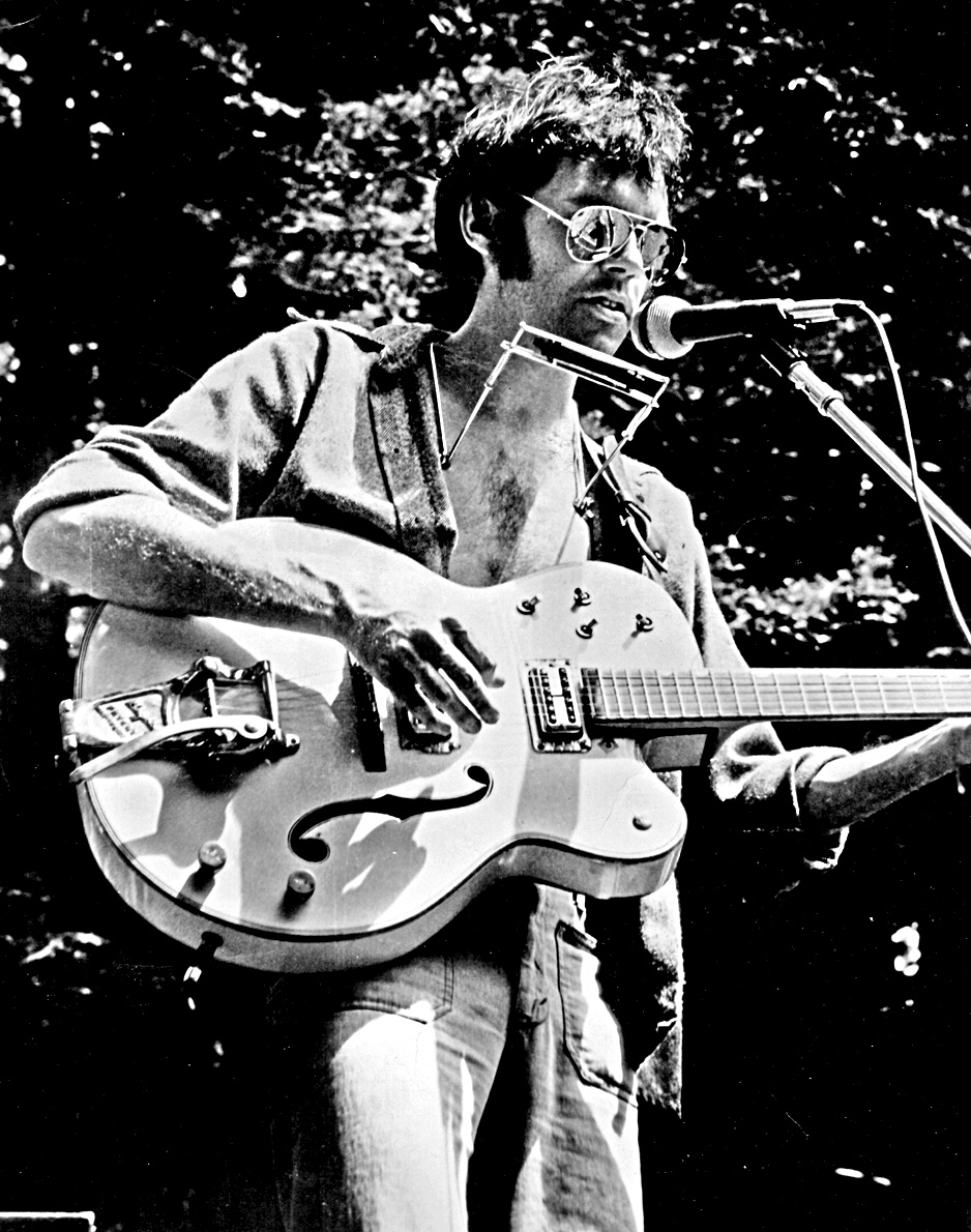 Black and white photo of Neil Young.