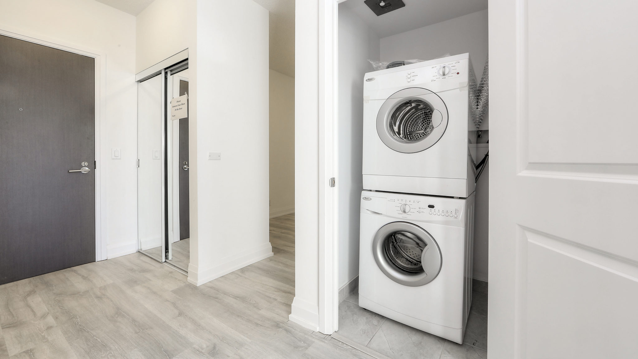 Image showing washer and dryer one on top of another to save space.