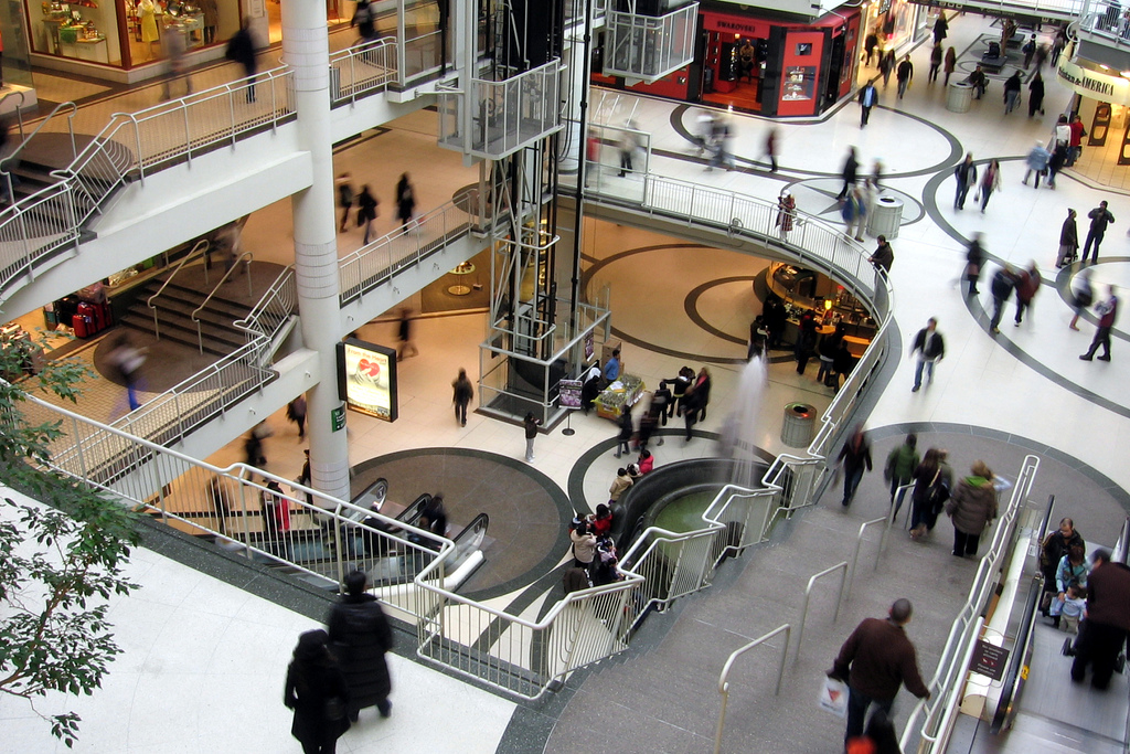 View of Eaton Centre looking down. It seems like many of the people are blurred.
