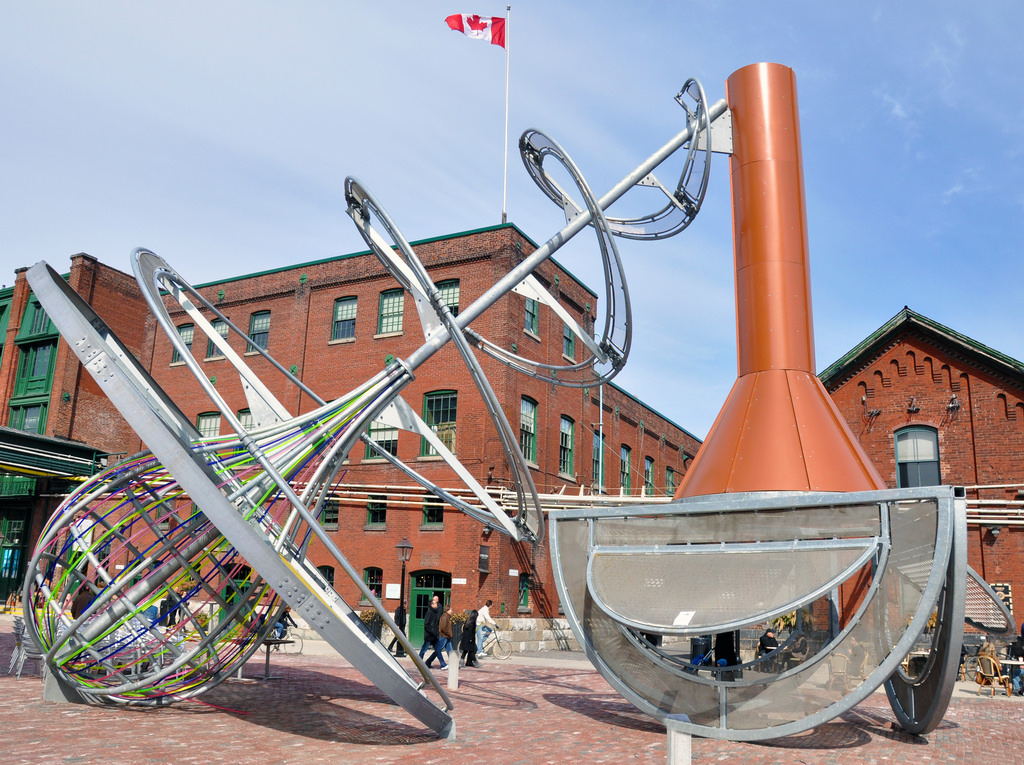 Pic of Toronto's Distillery District. We can see a rather large public artwork.
