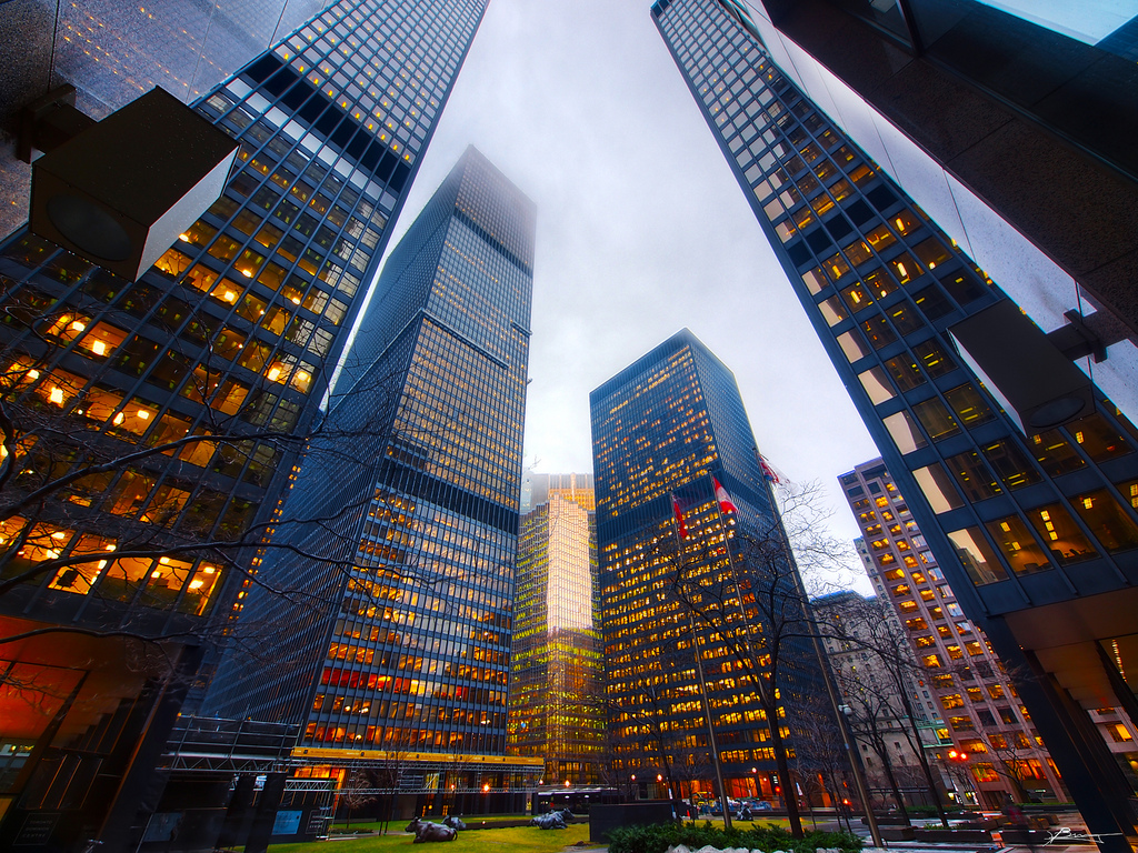 Photograph of buildings in Toronto's Financial District. We can see so many lights, but less of their tops because of the fog.