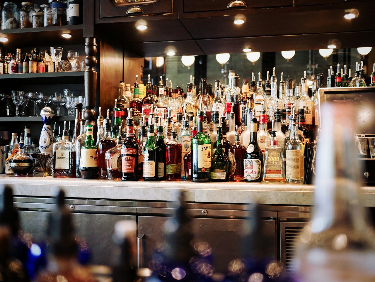 Photo of bar packed with so many drinks.