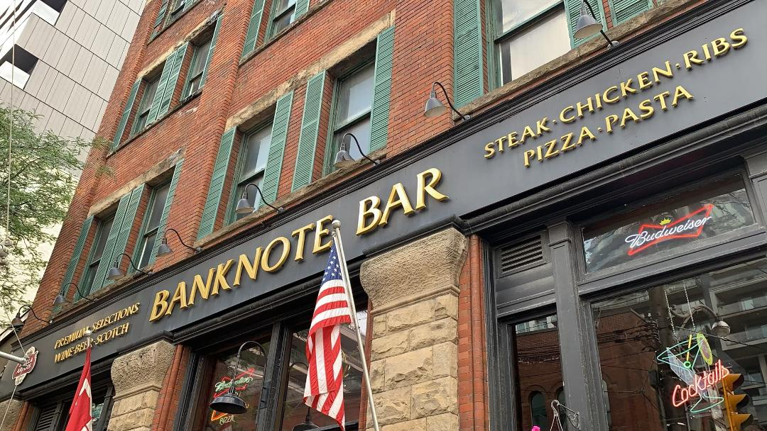 banknote bar gold black sign american flag king st w toronto