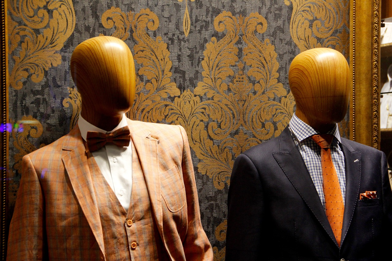 Male mannequins in fancy suits on King West.