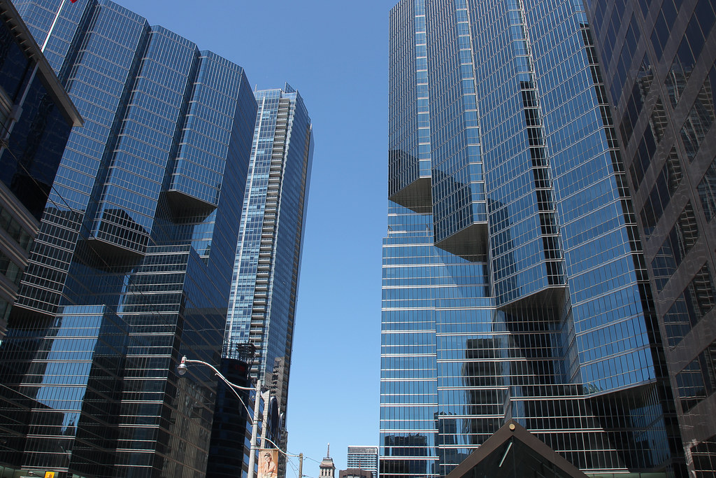 Tall office buildings and condos with blue glass along King Street West Toronto