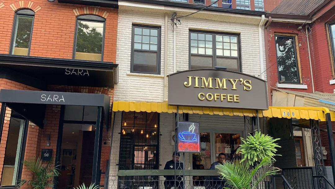 Jimmy's Coffee sign next to Sara's Restaurant in Toronto.