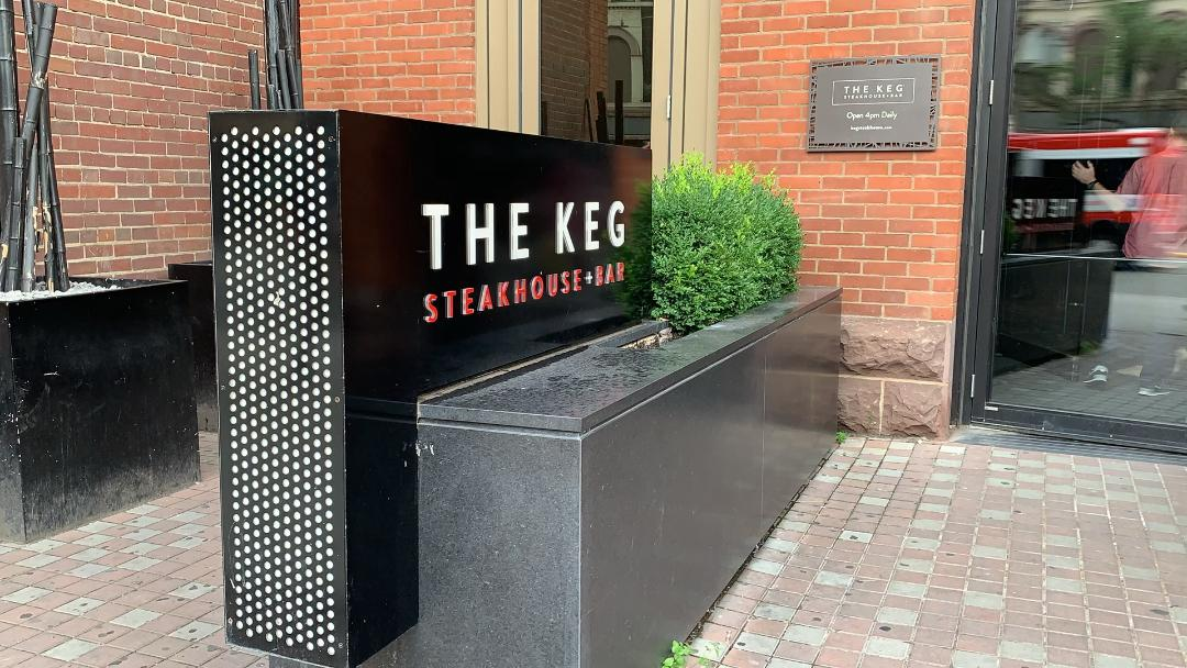 Large black and white sign for The Keg Steakhouse + Bar.