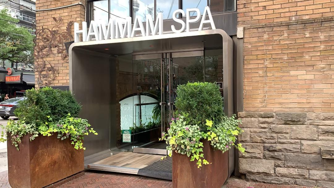 king west toronto hammam spa white sign brick exterior.