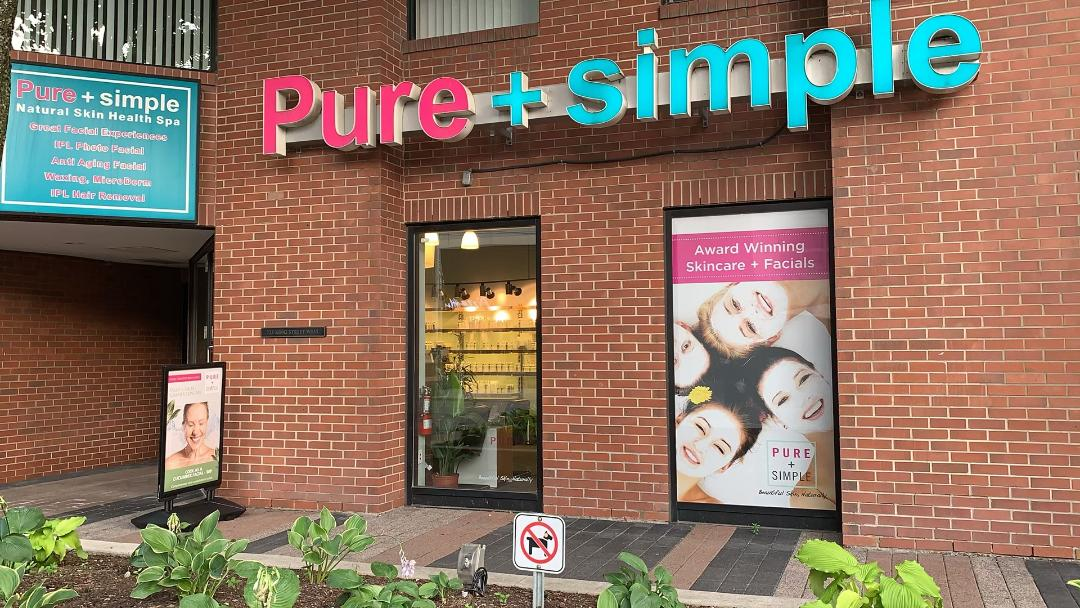 Pink blue pure + simple spa sign window posters King St W.