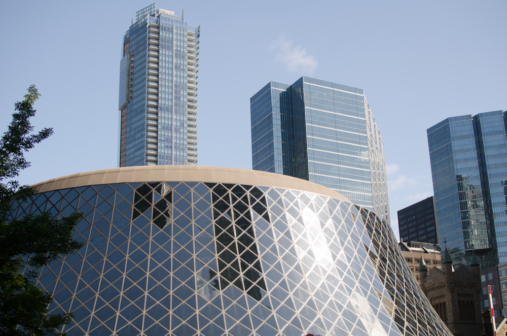 Dome of Roy Thompson Hall in Toronto with buildings in background.