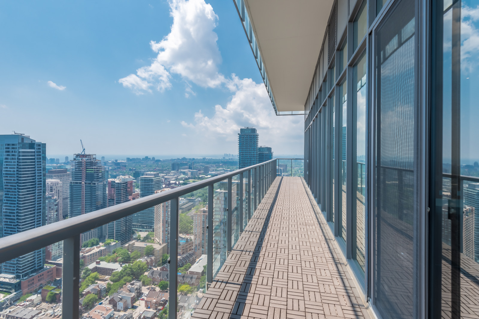Image of balcony: it's so long and shows a rather lovely view of Toronto.