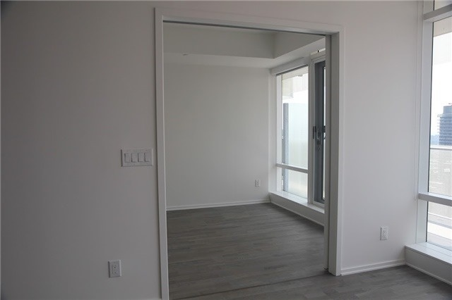 View of 1 Bloor Unit 3809 master bedroom and balcony.