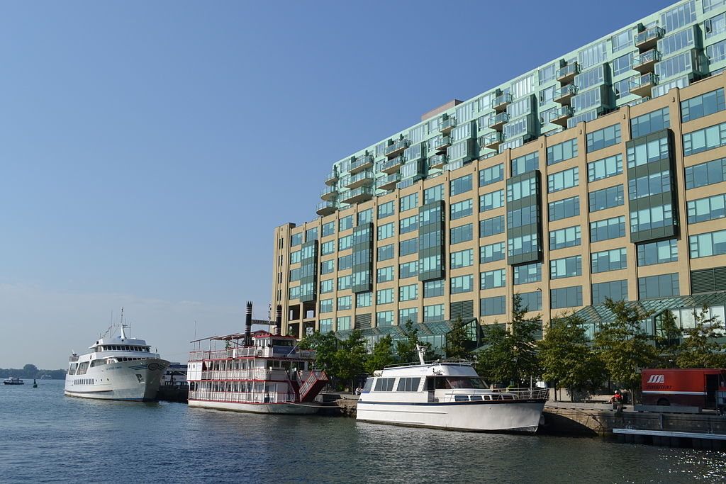 Photo of Queens Quay Terminal and boats and water.