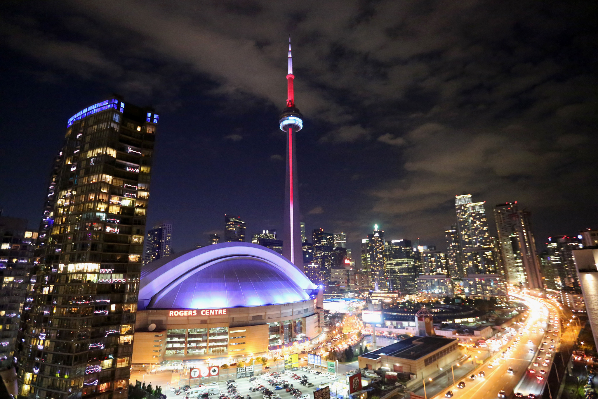 Gorgeous shot of CN Tower and Toronto at night, with so many twinkling lights.