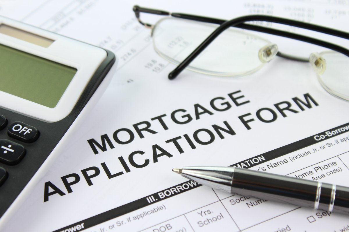 Photo of a mortgage application form for a fixed rate mortgage and also a pen and glasses.