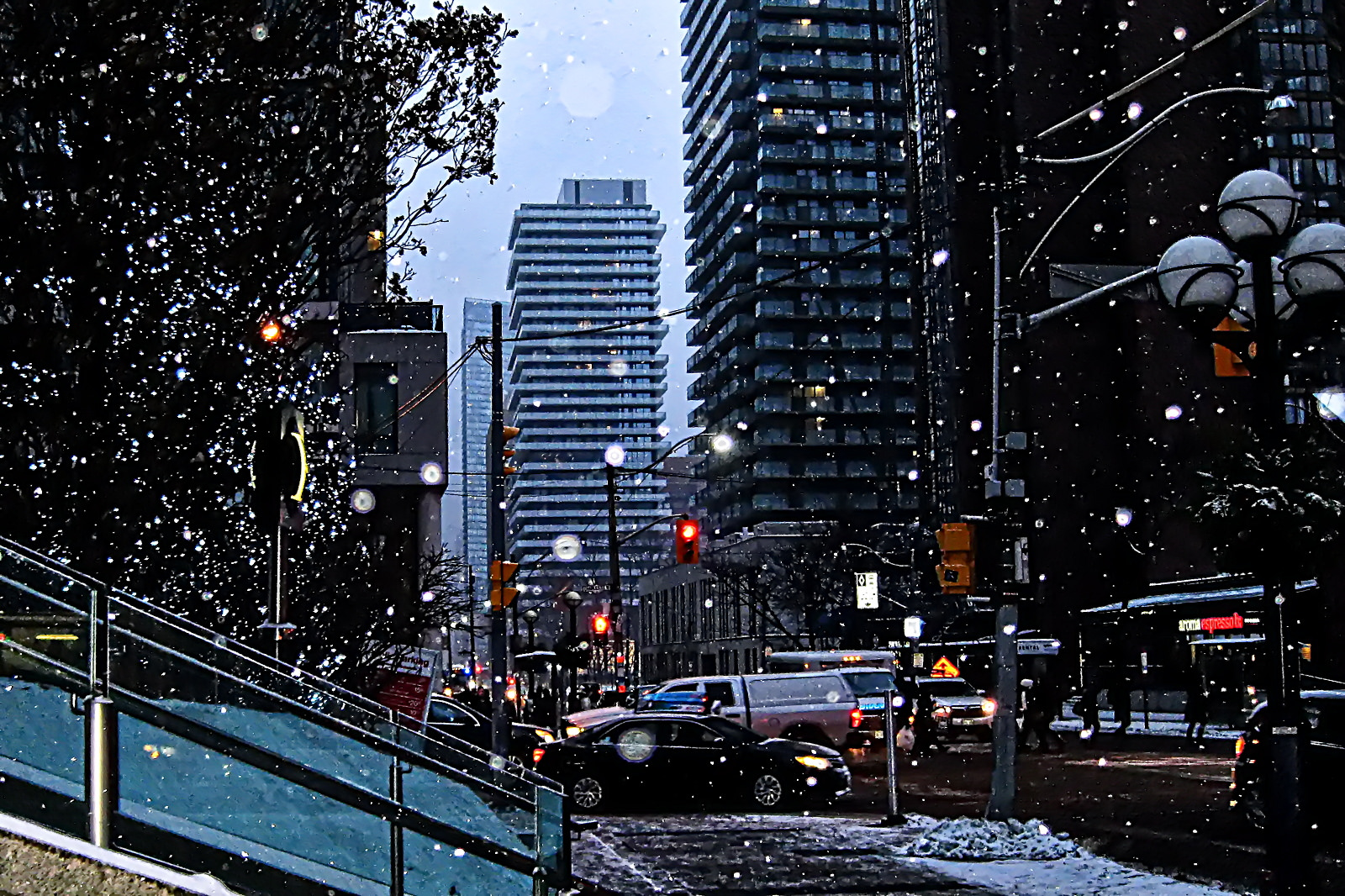 Photo of Toronto in winter and we see snow and buildings and cars and MLS.