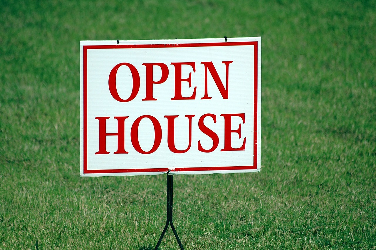Open house sign on lawn. So this illustrates how not every property sells just because there's an MLS listing. Hiring is also important.