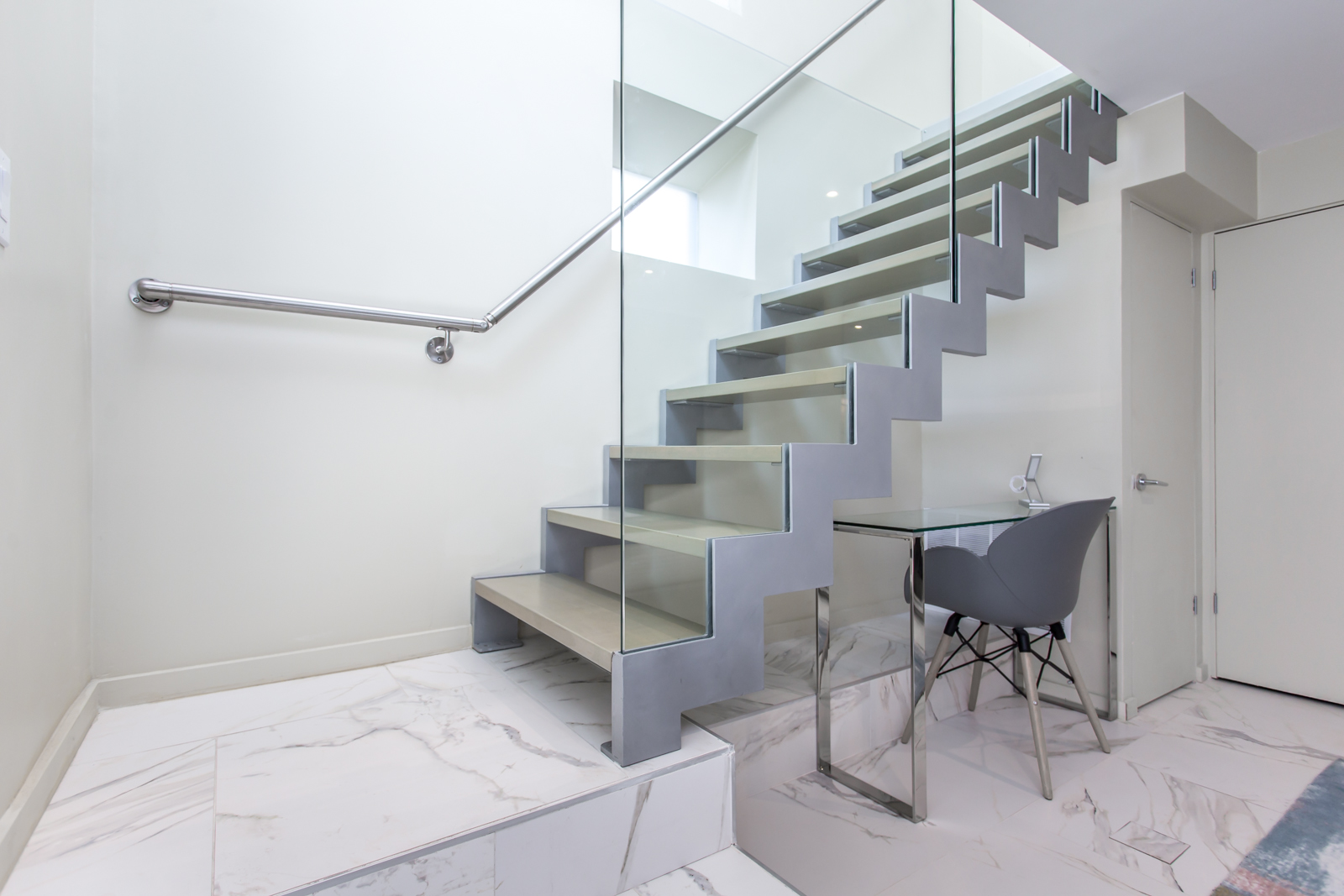 Another angle of staircase and we also see the office desk and chair.