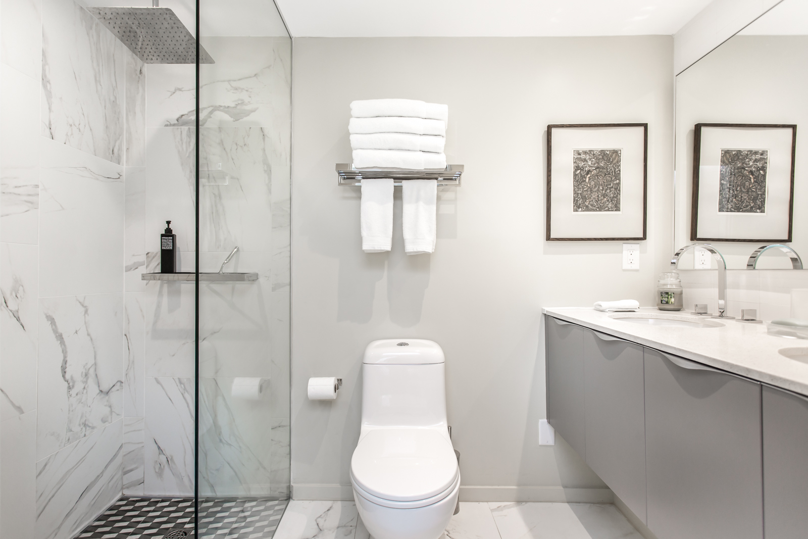 Photo of bathroom and it looks so beautiful with gray colours and simple layout.