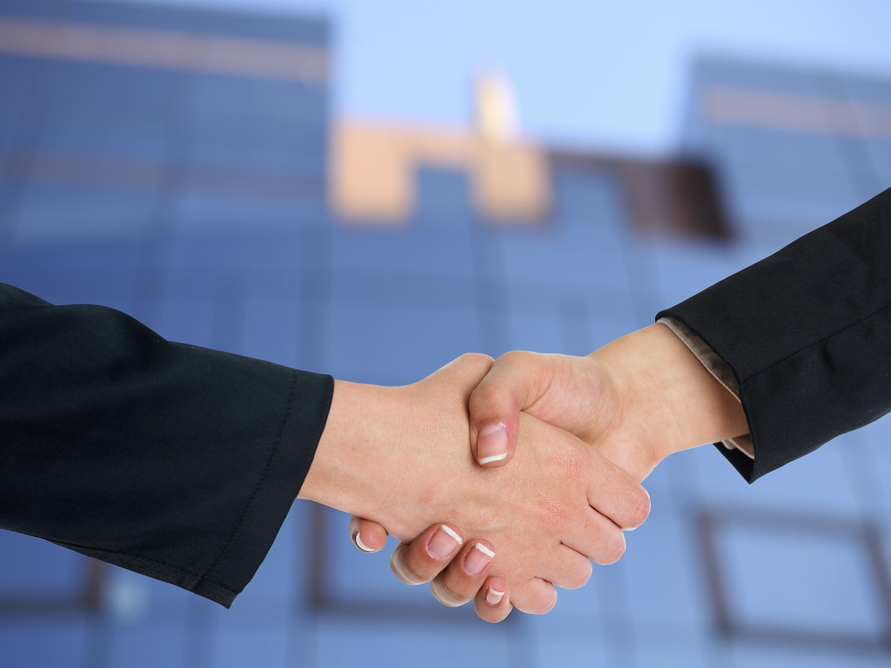 Handshake close up, showing deal between a real estate broker and client.