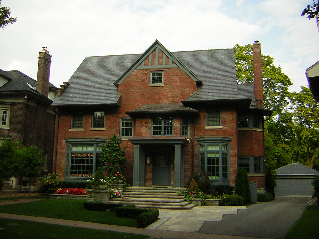 Redbrick mansion in Rosedale and also other houses on side.