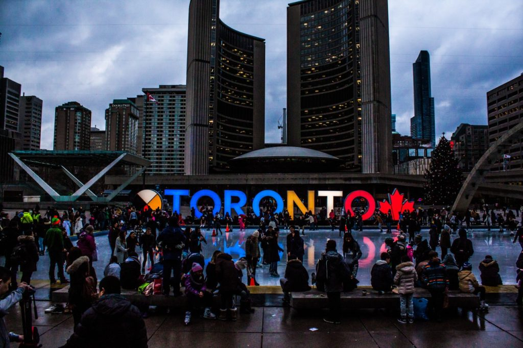 Toronto City Hall and crowds along the skating rink, showing how 2019 Forecast is optimistic.
