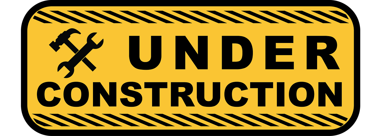 Under construction sign showing another one of the cons of buying a pre-construction condo is waiting.