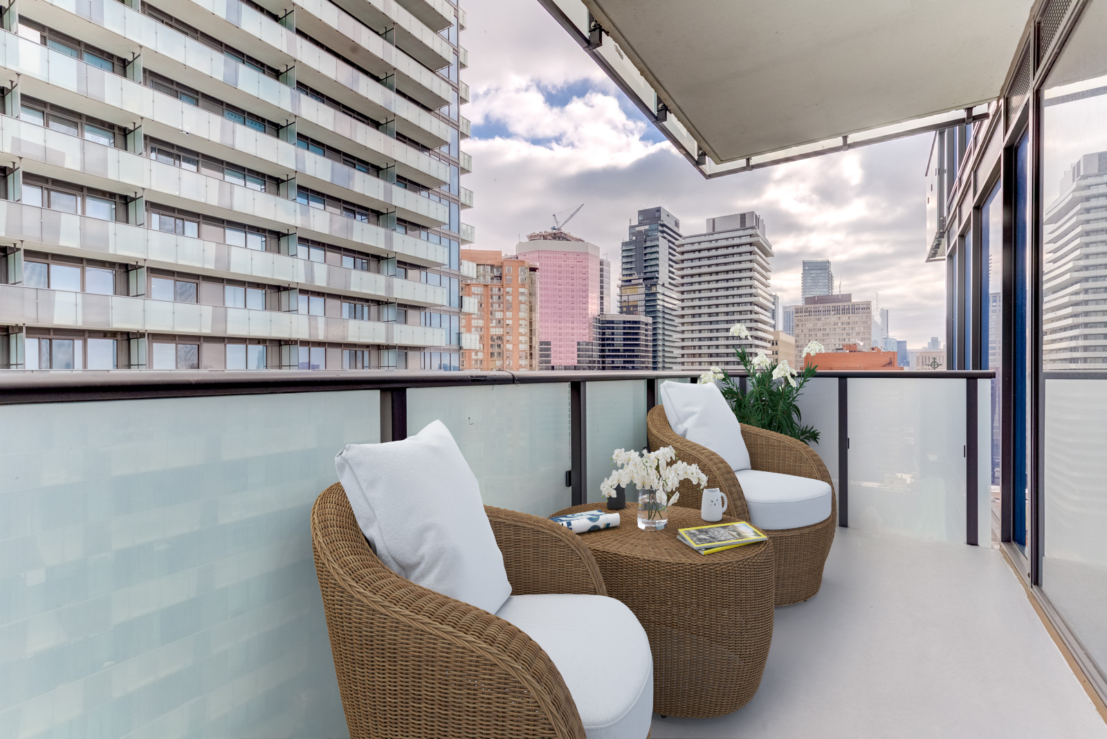 Master balcony and virtually staged furniture.