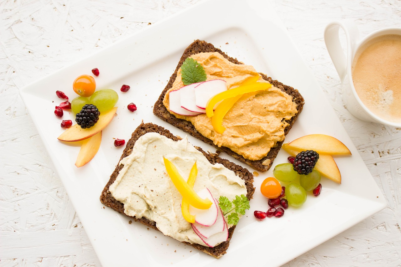 Vegan food including toast and fruits and vegetables.