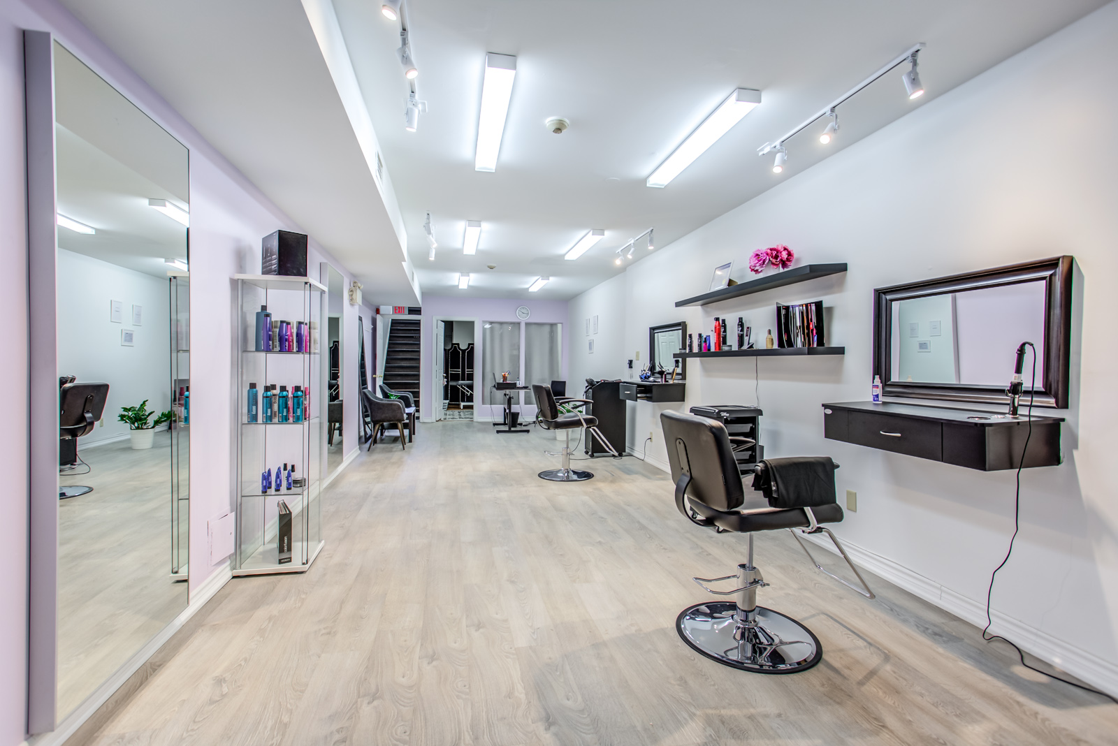 642 queen street west interior; hair salon with styling chairs and other items.